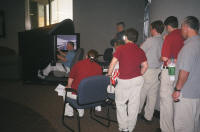 Crowd of future EMS graduates watches and learns