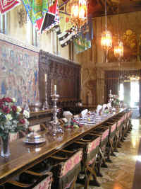 The grand dining room, with priceless tapestries all around